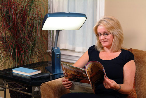 Woman using Carex Health Brands Day Light Sky to read