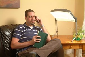 Carex Day-Light featured image being used by a man on the phone