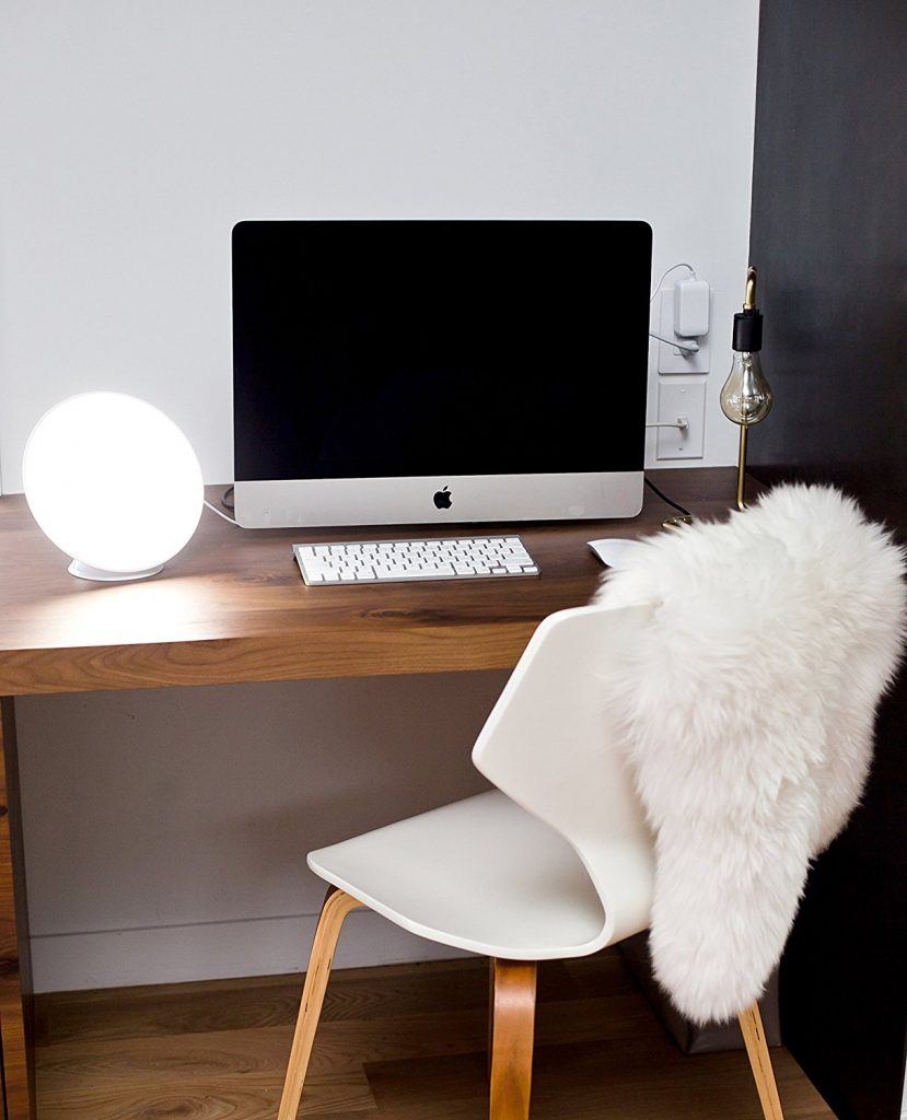 Circadian Optics Lampu Light Therapy Lamp in use on a desk